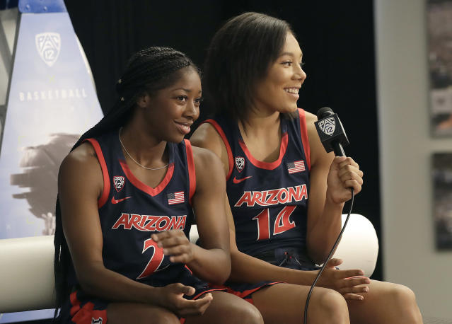 Arizona's Sam Thomas, right, answers questions next to Aarion McDonald during NCAA college basketball Pac-12 media day in San Francisco, Wednesday, Oct. 10, 2018. (AP Photo/Jeff Chiu)