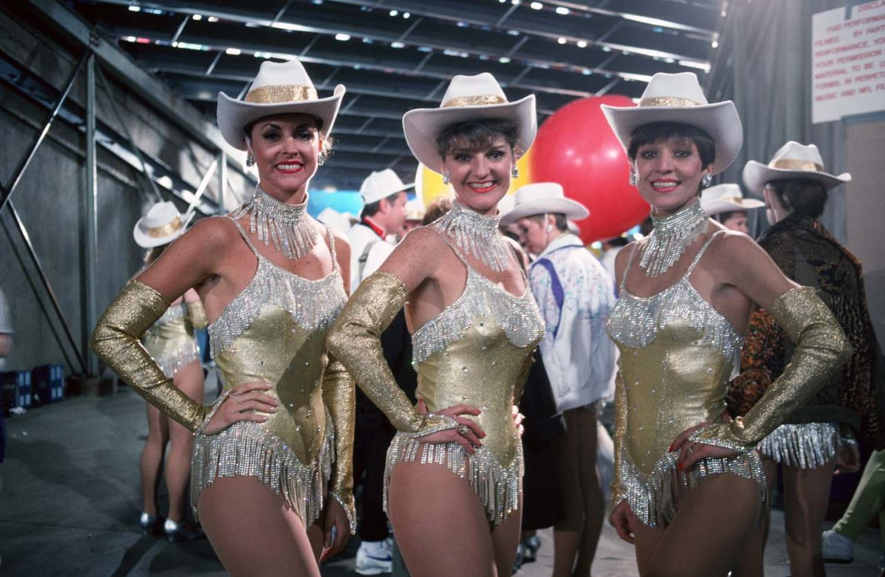 PASADENA, CA - 1993:  Three members of the Dallas Cowboy Cheerleaders pose in the tunnel at the Rose Bowl during a 1993 Pasadena, California, halftime portrait. The Buffalo Bills lost to the Dallas Cowboys 52 to 17. (Photo by George Rose/Getty Images)