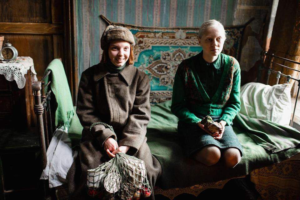 """<p>Dramas don't come much bleaker than <em>Beanpole</em>, director Kantemir Balagov's wrenching story about the damage caused by war, and the exceedingly high cost of survival. In a 1945 Leningrad still recovering from the end of WWII, lanky Iya (Viktoria Miroshnichenko), aka """"Beanpole,"""" works as a nurse even though her military service has left her with a condition in which she becomes temporarily frozen. Iya cares for Pashka (Timofey Glazkov), the young son of her frontlines friend Masha (Vasilisa Perelygina), and when Masha appears to reclaim her child – only to learn of an unthinkable tragedy – their relationship buckles under the weight of grief, guilt, regret, resentment and need. Cruel blackmail soon proves to be Masha's means of coping with loss, but healing is in short supply in this ravaged milieu. Shot in alternately tremulous and composed handheld, director Balagov's long takes place a premium on close-ups, the better to convey the dizzying anguish of his subjects, who are as decimated as their environment. Overpoweringly desolate and moving, it's a vision of paralyzing individual, and national, PTSD – and, ultimately, of women banding together to forge a new future.</p><p><a class=""""link rapid-noclick-resp"""" href=""""https://www.amazon.com/Beanpole-Viktoria-Miroshnichenko/dp/B08779C6LM/?tag=syn-yahoo-20&ascsubtag=%5Bartid%7C10054.g.29500577%5Bsrc%7Cyahoo-us"""" rel=""""nofollow noopener"""" target=""""_blank"""" data-ylk=""""slk:Watch Now"""">Watch Now</a></p>"""