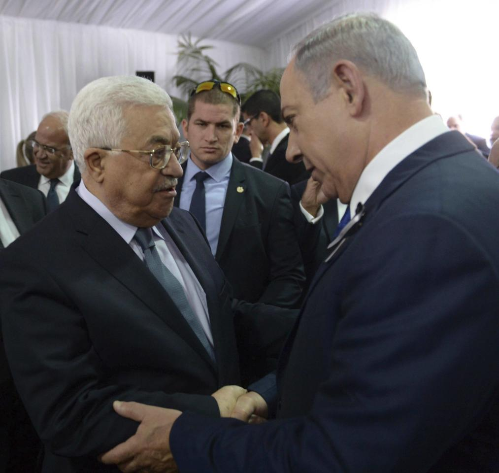 "<p> FILE - This Sept. 30, 2016 file image released by the Israeli Government Press Office shows Palestinian President Mahmoud Abbas, left, shaking hands with Israeli Prime Minister Benjamin Netanyahu, right, at the funeral for former President Shimon Peres in Jerusalem. Donald Trump may be uniquely suited to push for a creative Middle East peace: both the Israelis and key Arab players, each for their own reasons, are looking like wary admirers who seek to please. But the reasons why Israelis and Palestinians have failed to reach a final peace agreement remain stubbornly in place, and so the search is on for an out-of-the-box ""deal."" The focus could eventually fall on a partial peace deal that breaks the diplomatic logjam by avoiding excessive ambition. (Amos Ben Gershom, Israeli Government Press Office via AP, File) </p>"