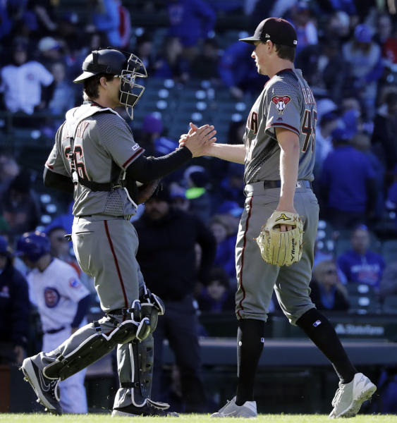 Arizona Diamondbacks relief pitcher Taylor Clarke, right, celebrates with catcher John Ryan Murphy after the Diamondbacks defeated the Chicago Cubs in a baseball game Saturday, April 20, 2019, in Chicago. (AP Photo/Nam Y. Huh)