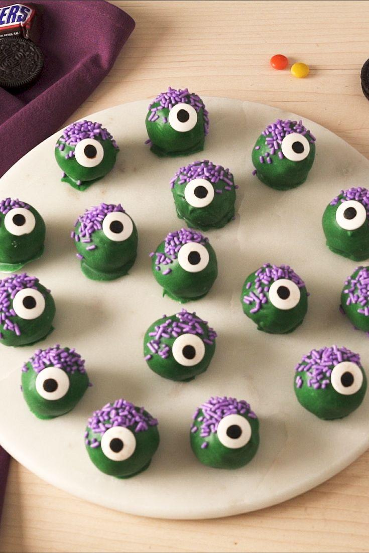 """<p>These scary cute no-bake monsters are essentially <a href=""""https://www.delish.com/cooking/recipe-ideas/recipes/a48823/oreo-truffles-recipe/"""" rel=""""nofollow noopener"""" target=""""_blank"""" data-ylk=""""slk:Oreo Truffles"""" class=""""link rapid-noclick-resp"""">Oreo Truffles</a> all dressed up for Halloween.<br></p><p>Get the recipe from <a href=""""https://www.delish.com/holiday-recipes/halloween/a34535034/monster-truffles-recipe/"""" rel=""""nofollow noopener"""" target=""""_blank"""" data-ylk=""""slk:Delish"""" class=""""link rapid-noclick-resp"""">Delish</a>.</p>"""