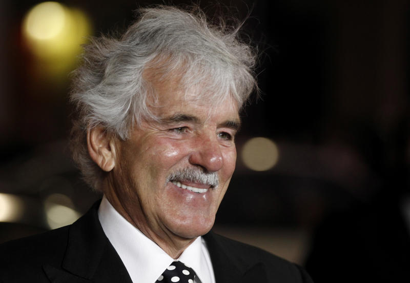 """FILE - In this Jan. 25, 2012 file photo, Dennis Farina arrives at the premiere for the HBO television series """"Luck"""" in Los Angeles. Farina died suddenly on Monday, July 22, 2013, in Scottsdale, AZriz., after suffering a blood clot in his lung. He was 69. (AP Photo/Matt Sayles, File)"""