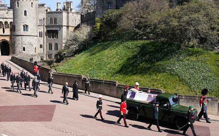 WINDSOR, ENGLAND - APRIL 17: The Royal Family walk behind Prince Philip, Duke of Edinburgh's coffin, carried by a Land rover hearse, in a procession during the funeral of Prince Philip, Duke of Edinburgh at Windsor Castle on April 17, 2021 in Windsor, United Kingdom. Prince Philip of Greece and Denmark was born 10 June 1921, in Greece. He served in the British Royal Navy and fought in WWII. He married the then Princess Elizabeth on 20 November 1947 and was created Duke of Edinburgh, Earl of Merioneth, and Baron Greenwich by King VI. He served as Prince Consort to Queen Elizabeth II until his death on April 9 2021, months short of his 100th birthday. His funeral takes place today at Windsor Castle with only 30 guests invited due to Coronavirus pandemic restrictions. (Photo by Paul Edwards-WPA Pool/Getty Images) - Paul Edwards/WPA Pool/Getty Images