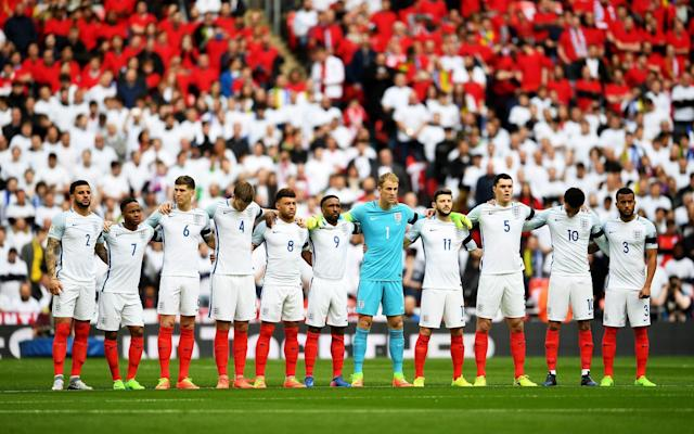 <span>Lion-up: The England team observe a one-minute silence to remember those who lost their lives in the recent Westminster incident</span> <span>Credit: Getty Images </span>