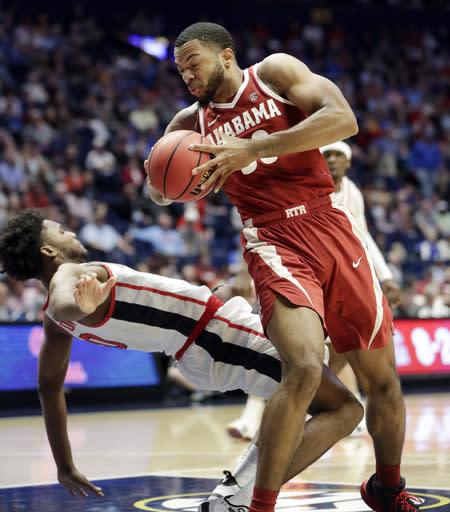 Alabama forward Galin Smith, right, collides with Mississippi guard Blake Hinson (0) in the first half of an NCAA college basketball game at the Southeastern Conference tournament Thursday, March 14, 2019, in Nashville, Tenn. (AP Photo/Mark Humphrey)