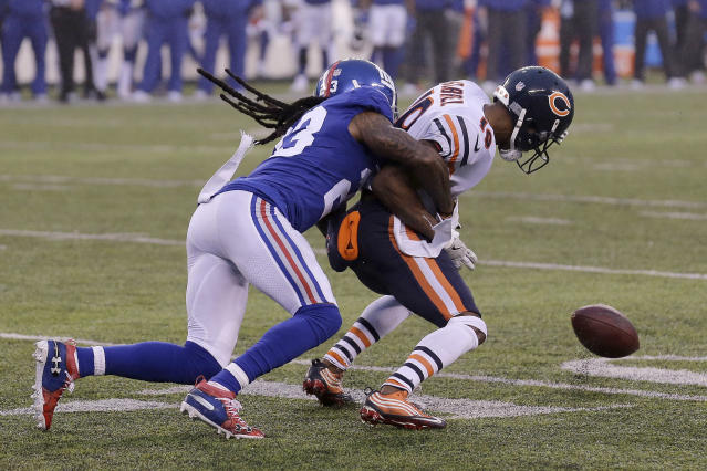 New York Giants cornerback B.W. Webb, left, forces a fumble on Chicago Bears wide receiver Taylor Gabriel during the second half of an NFL football game, Sunday, Dec. 2, 2018, in East Rutherford, N.J. (AP Photo/Seth Wenig)