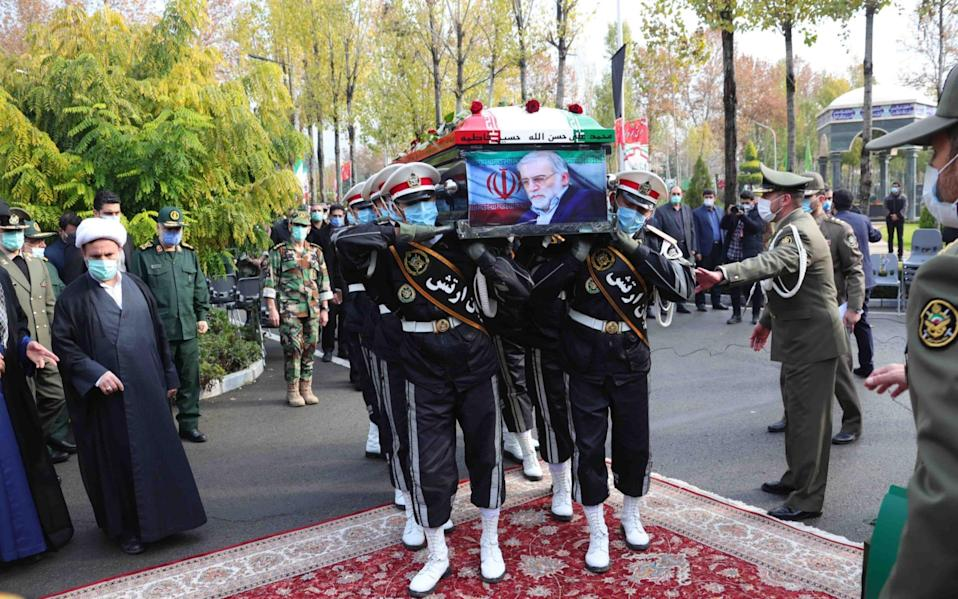 Soldiers carry the coffin of slain Iranian nuclear scientist Mohsen Fakhrizadeh during funeral procession inside the Iranian defense ministry - DEFENCE MINISTRY OFFICE HANDOUT/EPA-EFE/Shutterstock /Shutterstock