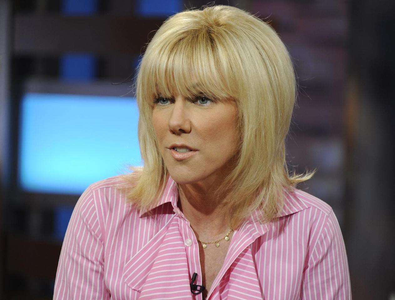"""This image released by ABC shows Rielle Hunter during an interview on the morning show """"Good Morning America,"""" Tuesday, June 26, 2012 in New York. Hunter says she and former presidential candidate John Edwards have ended their relationship. Hunter told ABC's """"Good Morning America"""" on Tuesday that she and Edwards were still a couple until late last week, as details from Hunter's memoir """"What Really Happened: John Edwards, Our Daughter and Me,"""" became public. The breakup was painful, but Hunter said Edwards will still be involved with their daughter, Quinn, who is 4 years old and lives with Hunter. (AP Photo/ABC, Ida Mae Astute)"""