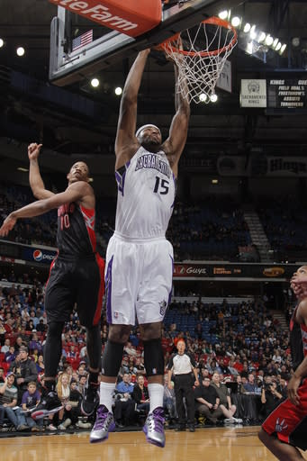 SACRAMENTO, CA - DECEMBER 5: DeMarcus Cousins #15 of the Sacramento Kings dunks the ball against DeMar DeRozan #10 of the Toronto Raptors on December 5, 2012 at Sleep Train Arena in Sacramento, California. (Photo by Rocky Widner/NBAE via Getty Images)