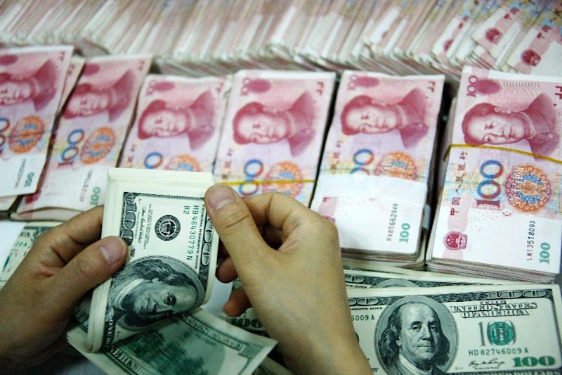Authorities lowered the yuan's central rate against the US dollar by nearly five percent in a single week, which should make Chinese exports cheaper on world markets (AFP Photo/-)