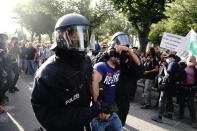 Police take a man away at the boulevard Unter den Linden during a protest against Corona measures in Berlin, Germany, Saturday, Aug. 29, 2020. (Kay Nietfeld/dpa via AP)