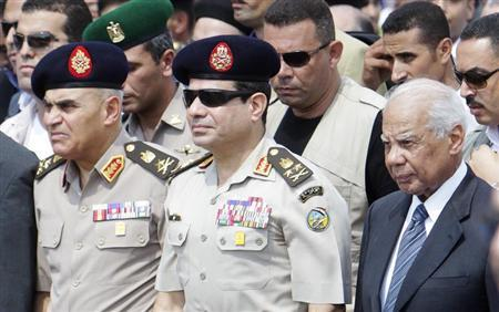 Army Chief General al-Sisi and interim PM el-Beblawi attend the military funeral service of Police General Farag in Nasr City