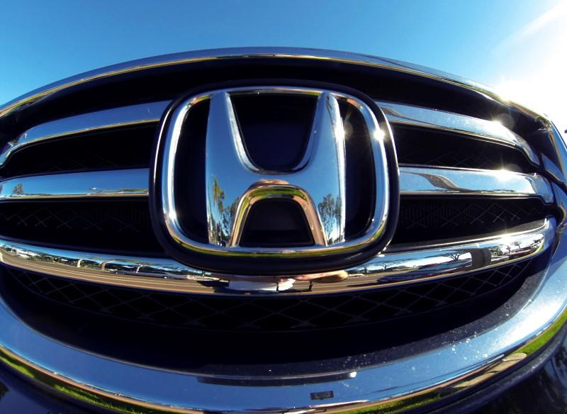 The front grill of a Honda truck is shown on car lot in Carlsbad, California