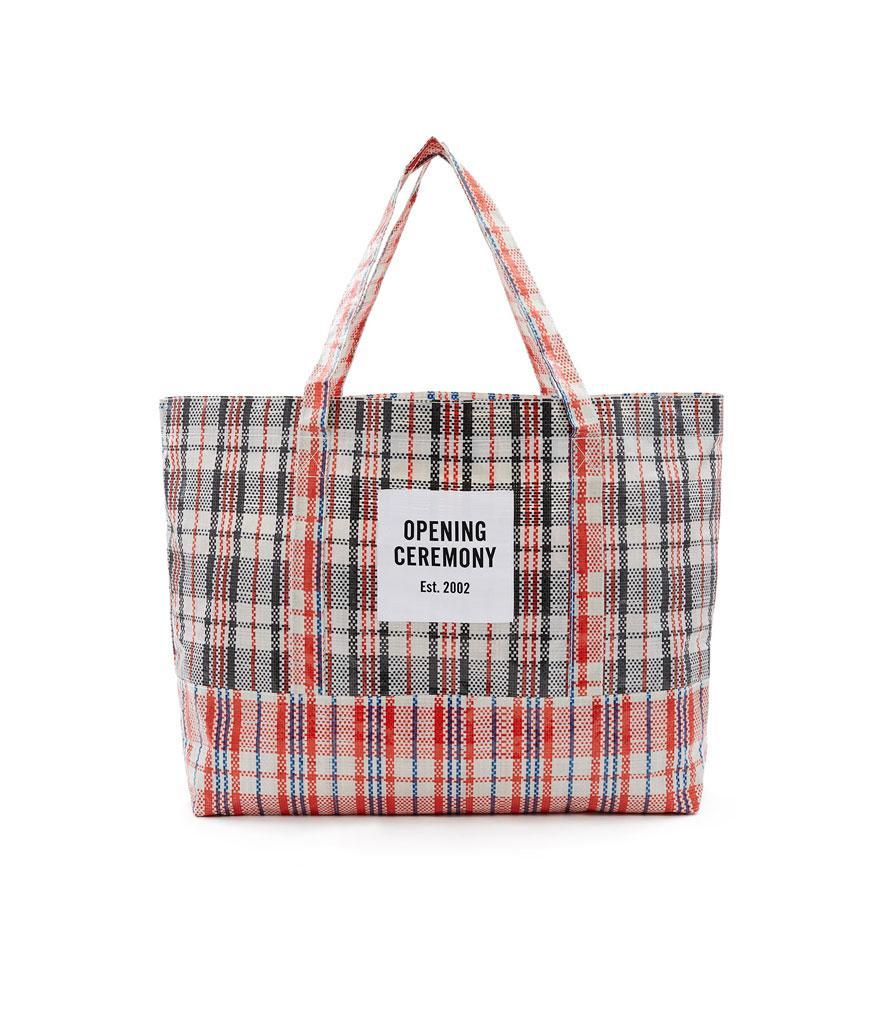 "<p>Large Plaid Tote Bag, $35,<a href=""https://www.openingceremony.com/mens/opening-ceremony/large-plaid-tote-bag-ST89707.html?gender=w"" rel=""nofollow noopener"" target=""_blank"" data-ylk=""slk:openingceremony.com"" class=""link rapid-noclick-resp""> openingceremony.com</a> </p>"