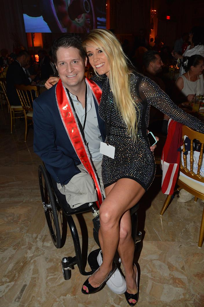 Brian Kolfage and wife Ashley Kolfage at the Mar-a-Lago resort in Palm Beach, Fla., in 2019. (Patrick McMullan/Patrick McMullan via Getty Images)
