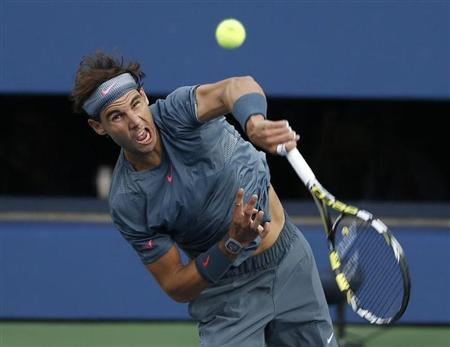 Nadal of Spain serves to Djokovic of Serbia in their men's final match at the U.S. Open tennis championships in New York