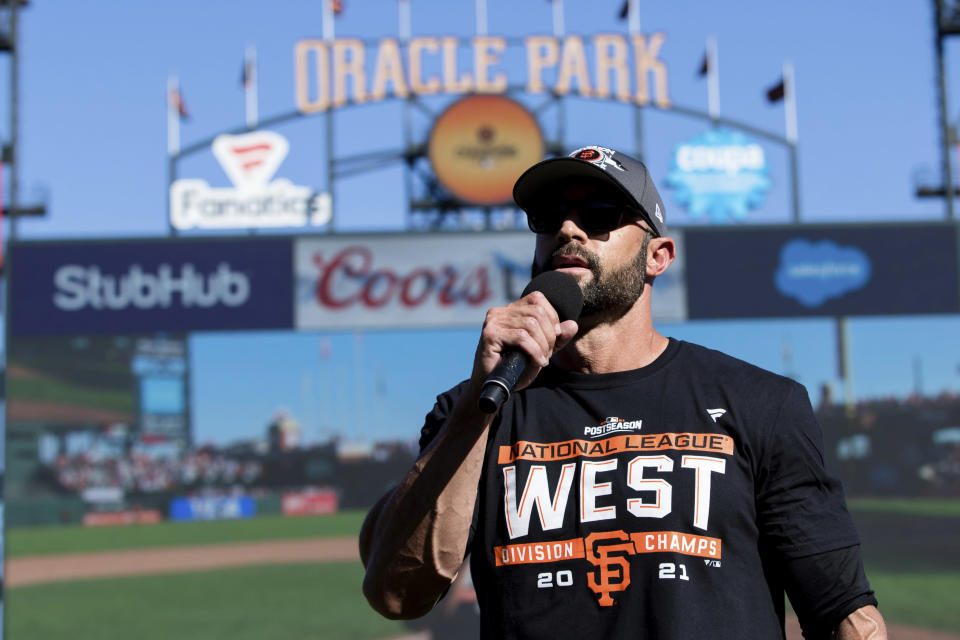 San Francisco Giants manager Gabe Kapler addresses the fans and his team after they defeated the San Diego Padres in a baseball game in San Francisco, Sunday, Oct. 3, 2021. The Giants won the National League West title. (AP Photo/John Hefti)