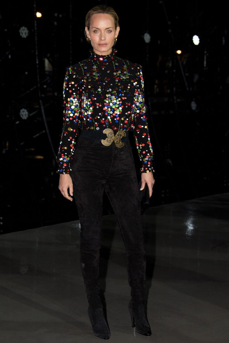 <p><strong>28 September </strong></p><p>Amber Valletta dressed in a rainbow metallic top for the Saint Laurent show at Paris Fashion Week.</p>
