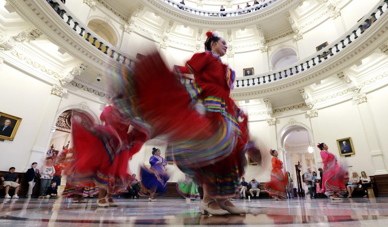 <p>Ballet Folklorico dancers from Rio Grande City perform in the Rotunda of the Texas State Capitol in Austin, Texas. (AP Photo/Eric Gay) </p>