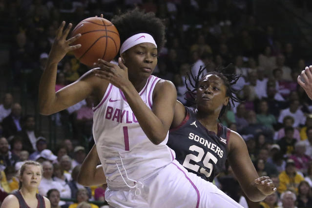 Baylor forward NaLyssa Smith (1) rebounds the ball against Oklahoma guard Madi Williams (25) in the first half of an NCAA college basketball game Saturday, Feb. 22, 2020, in Waco, Texas. (AP Photo/Jerry Larson)