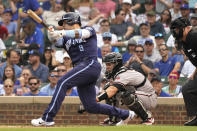 Chicago Cubs' Javier Baez hits a three-run home run during the first inning of a baseball game against the Arizona Diamondbacks in Chicago, Friday, July 23, 2021. (AP Photo/Nam Y. Huh)