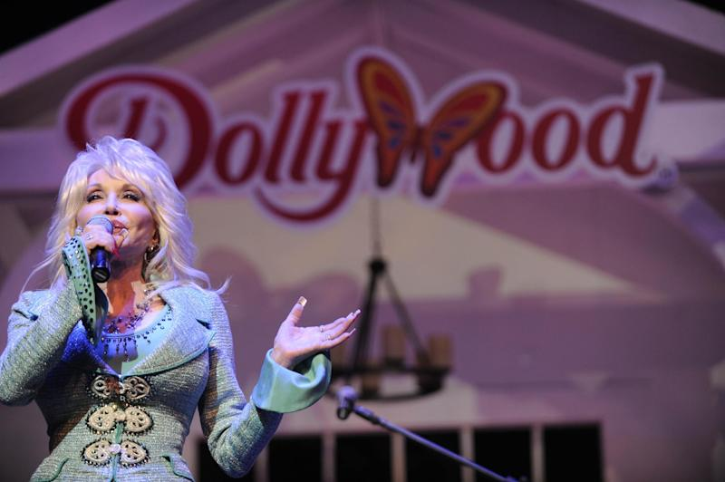 Dolly Parton speaks during a news conference to annouce plans to expand her Dollywood properties on Wednesday, Aug. 21, 2013, in Pigeon Forge, Tenn. Parton said she is going invest $300 million over the next 10 years in a project that includes a 300-room resort and a dual-launch coaster currently under construction in Dollywood. (AP Photo/Amy Smotherman Burgess, Knoxville News Sentinel)