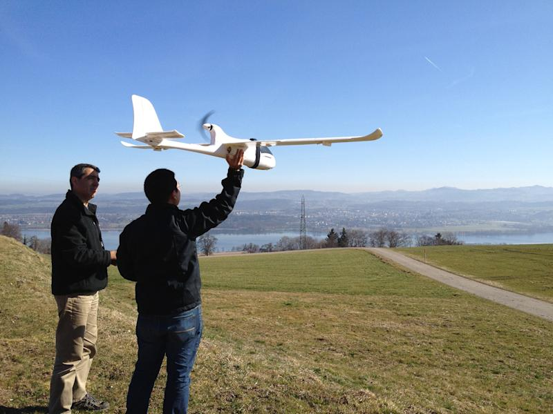In this March 15, 2012 photo released by ConservationDrones.org., conservation drone pioneer Lian Pin Koh, right, of the Swiss Federal Institute of Technology, and partner Serge Wich conduct a drone test flight in Zurich, Switzerland. This year, they have flown more than 200, mostly test runs in Asia using an improved 2.0 version of drone with a 2-meter (6.5 foot) wing span, air time of 45 minutes and a 25-kilometer (15.5-mile) range to track endangered wildlife, spot poachers and chart forest loss. (AP Photo/Juanita Choo-Koh, ConservationDrones.org) NO SALES, EDITORIAL USE ONLY