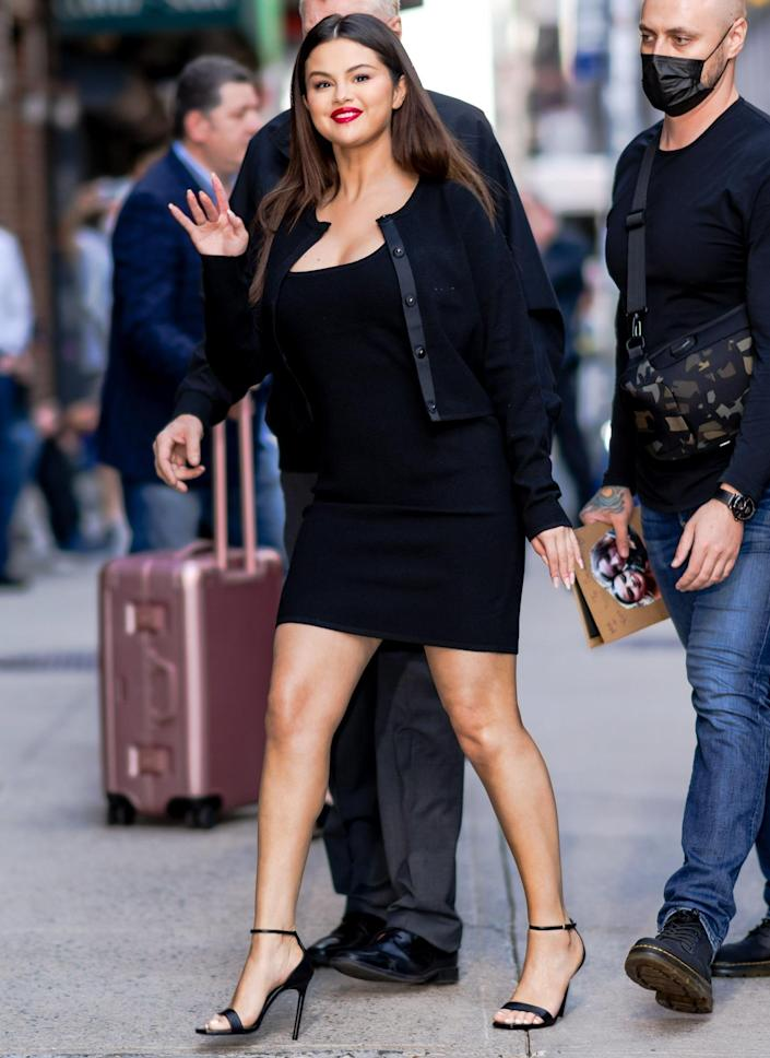 <p>Selena Gomez steps out in midtown N.Y.C. on Sept. 7 wearing a black dress paired with black strappy heels.</p>
