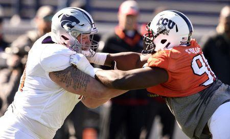 Jan 24, 2019; Mobile, AL, USA; North offensive tackle Dalton Risner of Kansas State (71) blocks against North defensive end L.J. Collier of TCU (91) during the North squad 2019 Senior Bowl practice at Ladd-Peebles Stadium. Mandatory Credit: John David Mercer-USA TODAY Sports