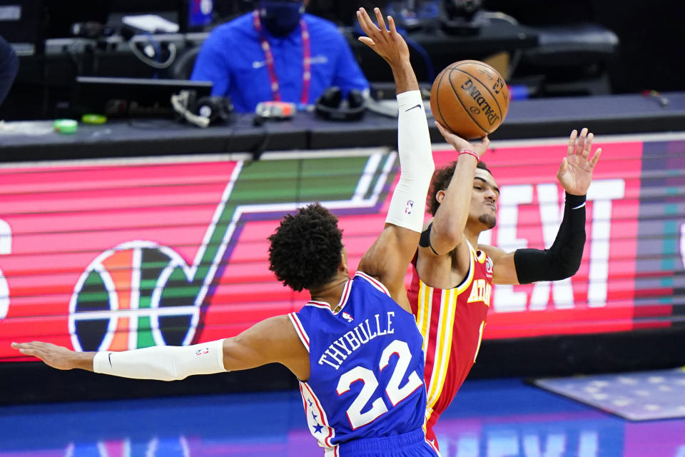 FILE - In this June 16, 2021, file photo, Atlanta Hawks' Trae Young, right, is fouled by Philadelphia 76ers' Matisse Thybulle during the second half of Game 5 in a second-round NBA basketball playoff series in Philadelphia. Players like Atlanta's Trae Young will have a tougher time drawing foul calls this season, with the NBA cracking down on non-basketball moves offensive players used to make to create contact with defenders. (AP Photo/Matt Slocum, File)