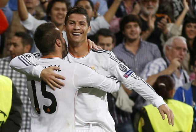 REFILE - CLARIFYING CAPTION Real Madrid's Cristiano Ronaldo (R) celebrates his goal against FC Copenhagen with team-mate Daniel Carvajal during their Champions League soccer match at Bernabeu stadium in Madrid October 2, 2013. REUTERS/Juan Medina (SPAIN - Tags: SPORT SOCCER)