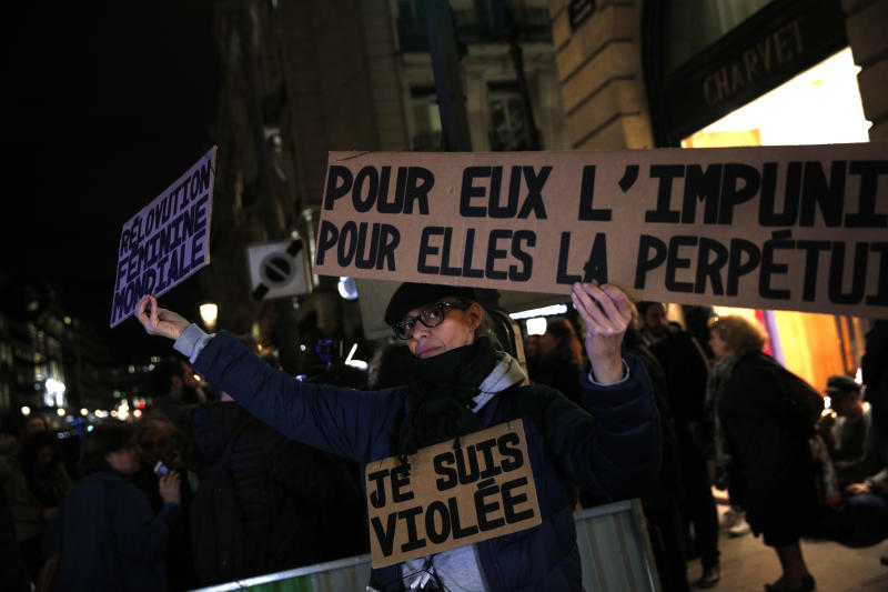 "FILE - A Tuesday, Nov. 14, 2017 file photo of an activist holding a banner reading: ""For him impunity, for her a life sentence"" during a protest in Paris. Justice Minister Nicole Belloubet provoked consternation by suggesting a legal minimum age of 13 for sexual consent ""is worth considering."" Activists protested in Paris to demand that the age of consent be set at 15. (AP Photo/Christophe Ena, File)"