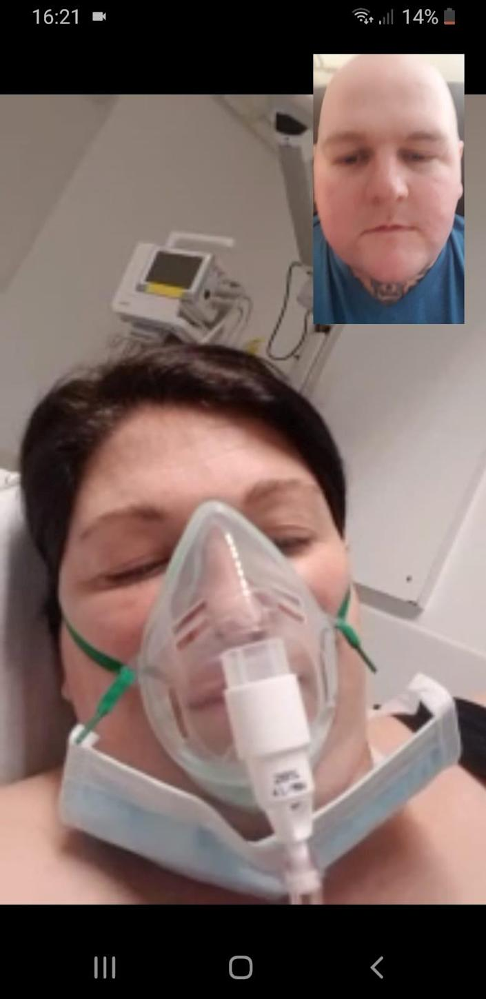 Danielle was in an induced coma for 10 days while pregnant with the twins, pictured here face-timing her partner. (SWNS)