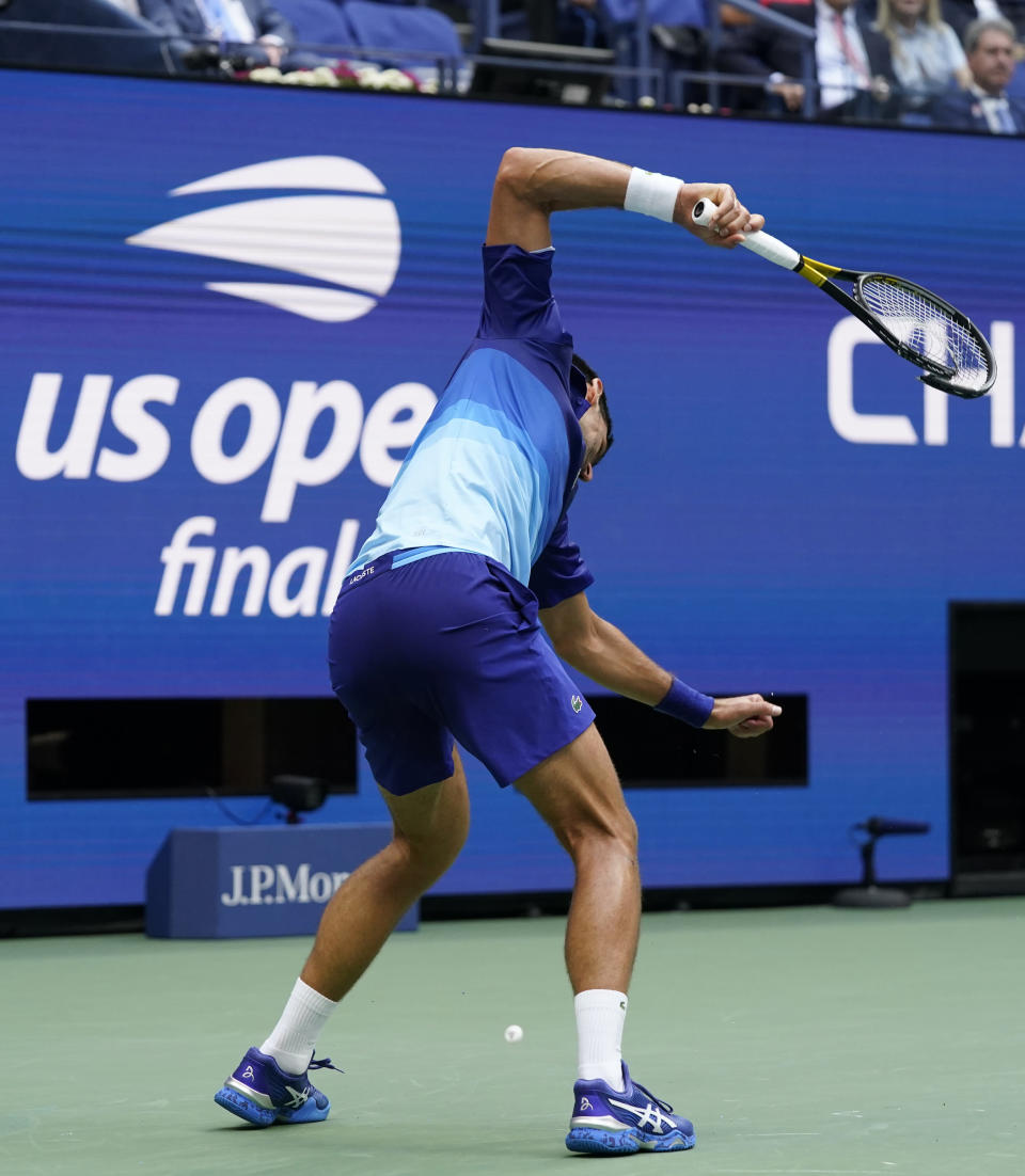 Novak Djokovic, of Serbia, smashes his racket after losing a point to Daniil Medvedev, of Russia, during the men's singles final of the US Open tennis championships, Sunday, Sept. 12, 2021, in New York. (AP Photo/Elise Amendola)