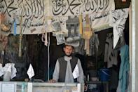 The Panjwai arms dealers also have Taliban flags and accessories for sale (AFP/JAVED TANVEER)