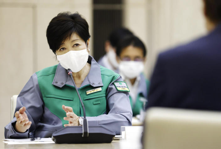 Tokyo Governor Yuriko Koike speaks during a meeting monitoring the new coronavirus situation, at the Metropolitan Government Office Wednesday, July 15, 2020, in Tokyo. Experts on Tokyo's coronavirus task force have raised caution levels for the infections in the Japanese capital to the highest on a scale of four, and urged officials to step up effort to secure more beds, increase testing capacities and raise awareness among the residents about the urgency. (Kenzaburo Fukuhara/Kyodo News via AP)