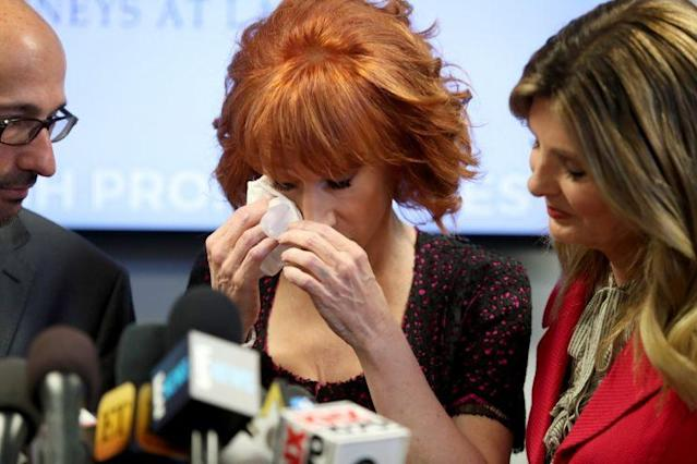 Kathy Griffin, center, and her attorney, Lisa Bloom, speak during a press conference at The Bloom Firm on June 2, 2017, in Woodland Hills, Calif. Griffin held the press conference after a controversial photoshoot — in which she held a bloodied mask of President Trump — to address alleged bullying by the Trump family. (Photo by Frederick M. Brown/Getty Images)