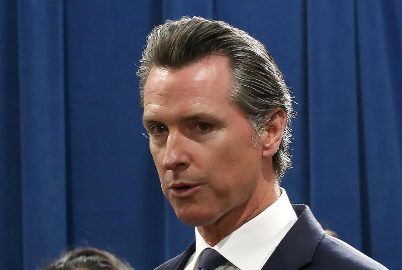California Gov. Gavin Newsom, discusses the lawsuit the state has filed against the Trump administration's new rules blocking green cards for many immigrants who receive government assistance, during a news conference in Sacramento, Calif., Friday, Aug. 16, 2019. California, three other states and the District of Columbia filed the suit Friday against some of the administration's most aggressive moves to restrict legal immigration that are supposed to take effect in October. (AP Photo/Rich Pedroncelli)
