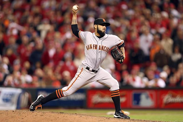 CINCINNATI, OH - OCTOBER 09: Sergio Romo #54 of the San Francisco Giants pitches in the 10th inning as the Giants defeat the Cincinnati Reds 2-1 in Game Three of the National League Division Series at the Great American Ball Park on October 9, 2012 in Cincinnati, Ohio. Romo earned the win in the victory. (Photo by Andy Lyons/Getty Images)