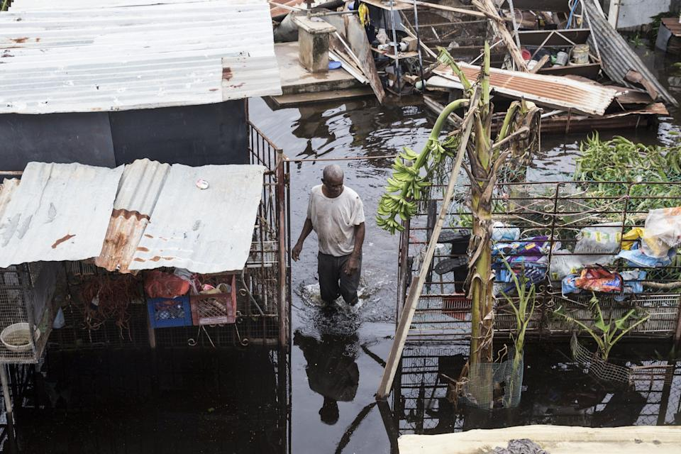 LOIZA, PUERTO RICO - SEPTEMBER 22: A resident wades through flood water days after Hurricane Maria made landfall,  on September 22, 2017 in Loiza, Puerto Rico. Many on the island have lost power, running water, and cell phone service after Hurricane Maria, a category 4 hurricane, passed through. (Photo by Alex Wroblewski/Getty Images)