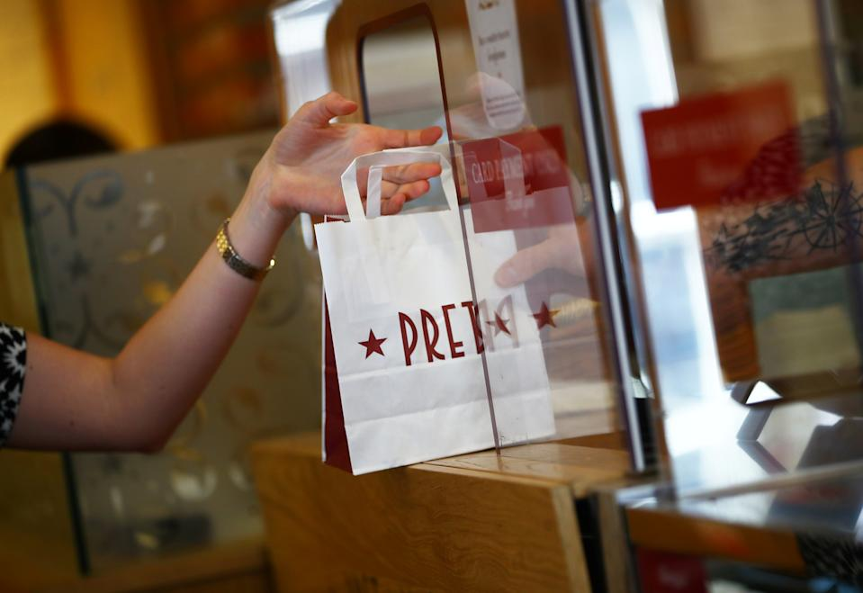 A bag is passed to a customer at Pret a Manger in New Cavendish Street, following the outbreak of the coronavirus disease (COVID-19), London, Britain, June 1, 2020. REUTERS/Hannah McKay