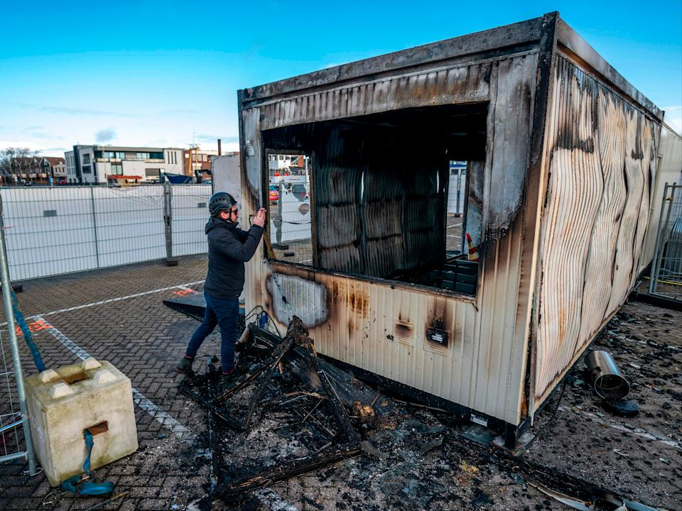 <p>Riot police were called in as young rioters torched a coronavirus test centre in Urk</p> (Jeroen Jumelet/ANP/AFP via Getty Images)