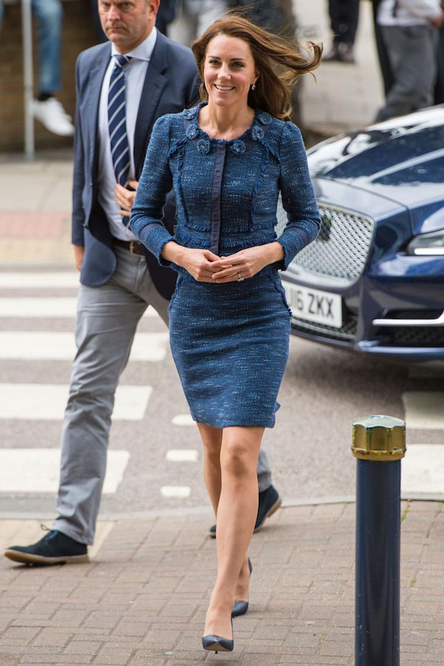 <p>In a navy tweed skirt suit and pointed toe pumps while visiting London terror attack victims at Kings College Hospital.</p>