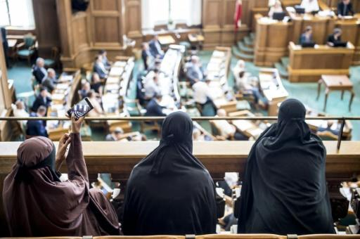 Women wearing niqab garments sat in the audience as the Danish parliament passed the ban against full-face veils in public