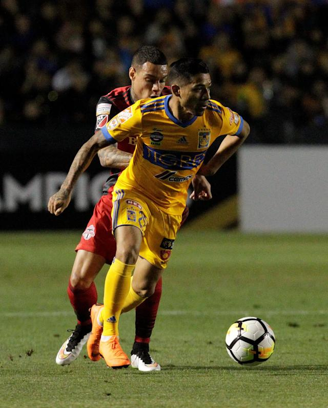 Soccer Football - Tigres v Toronto FC - CONCACAF Champions League - Universitario stadium, San Nicolas de los Garza, Mexico - March 13, 2018 - Javier Aquino of Tigres and Gregory Van Der Wiel of Toronto FC in action. REUTERS/Daniel Becerril