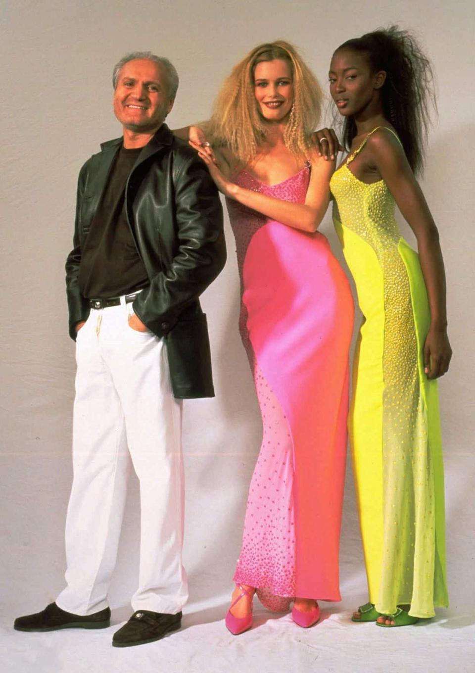 Claudia Schiffer and Naomi Campbell with Gianni Versace in 1996