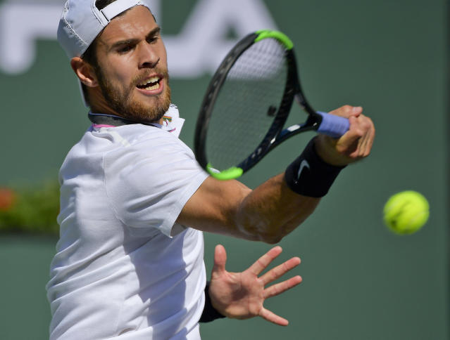 Karen Khachanov, of Russia, returns a shot to Rafael Nadal, of Spain, at the BNP Paribas Open tennis tournament Friday, March 15, 2019, in Indian Wells, Calif. (AP Photo/Mark J. Terrill)