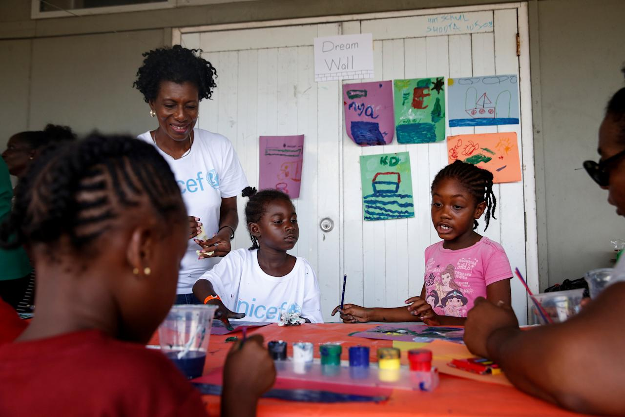 <p>Barbudan children paint in a shelter in Antigua for those forced to leave the island just after a month after Hurricane Irma struck the Caribbean islands of Antigua and Barbuda, October 7, 2017. REUTERS/Shannon Stapleton </p>