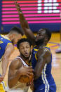 Cleveland Cavaliers forward Lamar Stevens, left, is defended by Golden State Warriors forward Draymond Green during the second half of an NBA basketball game in San Francisco, Monday, Feb. 15, 2021. (AP Photo/Jeff Chiu)